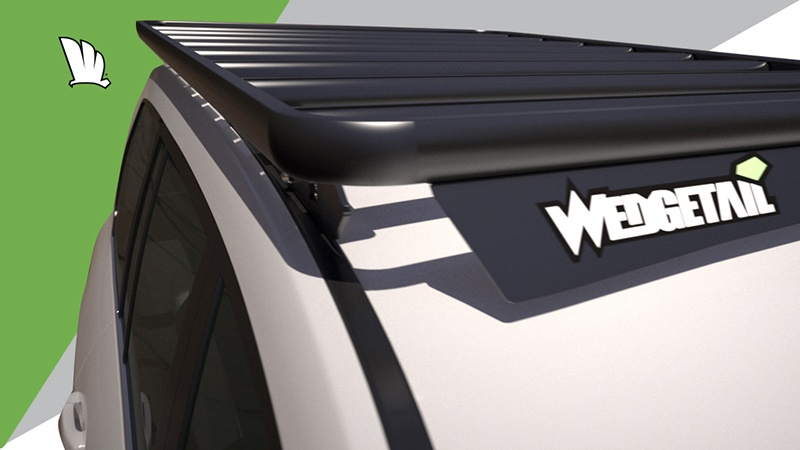Front view of the Wedgetail roof rack installed on a Toyota LandCruiser 200 Series showing the eight cross bars installed to give the platform its super strength and the wind deflector to provide minimal wind noise.