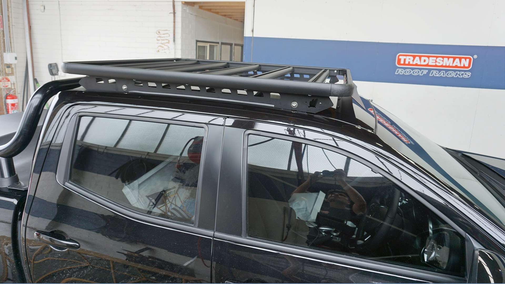 Raised side view of Navara with a Wedgetail roof rack installed showing the one piece mounting rails and the five cross bards used in the construction of the platform.