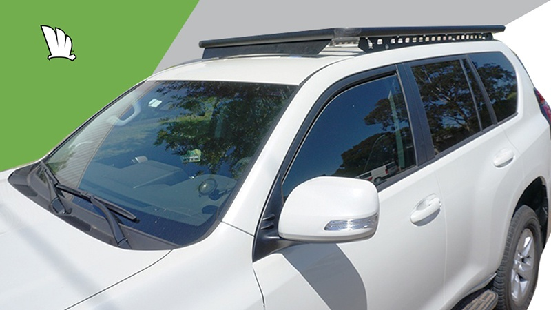 Front view of a Toyota Prado 150 Series with a Wedgetail roof rack installed showing the side rails and the front wind deflector.