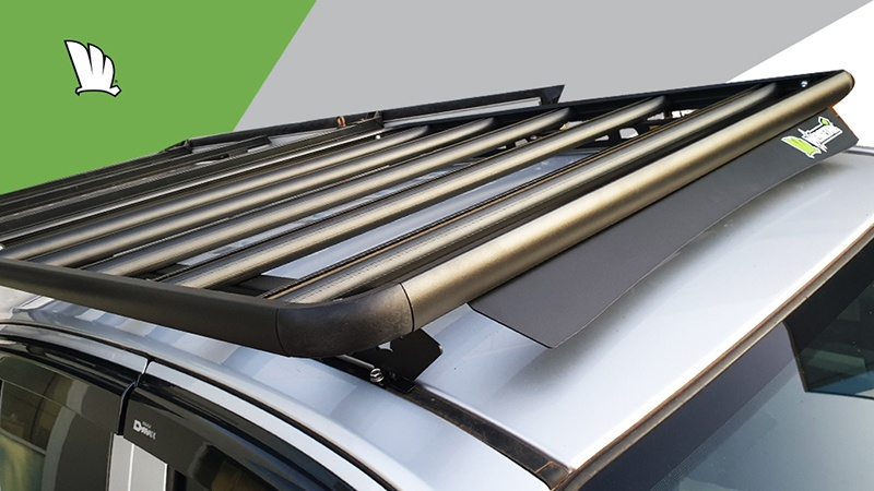 Image of front of roof with a Wedgetail rack installed showing wind deflector and one piece mounting rails.