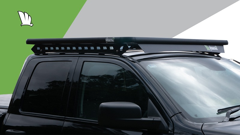 Side view of Dodge RAM 1500 with a Wedgetail roof rack installed on the cabin roof showing the mounting rails and the wind deflector.