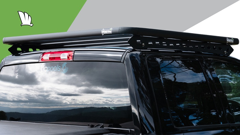 Rear view of Dodge RAM 1500 with a Wedgetail roof rack installed on the cabin roof showing the mounting rails.