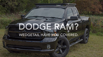Video banner with text reading Dodge RAM? Wedgetail have you covered. Background image is RAM 1500 with a Wedgetail roof rack installed.