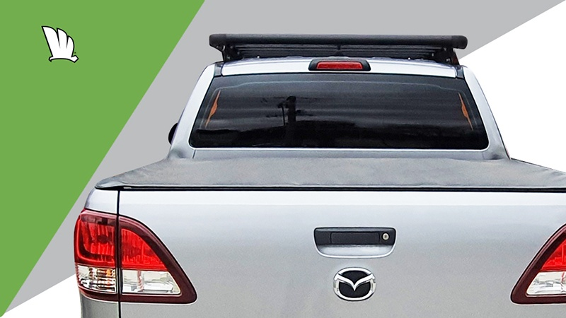 Mazda BT-50 rear view with a Wedgetail platform roof rack installed on the roof.