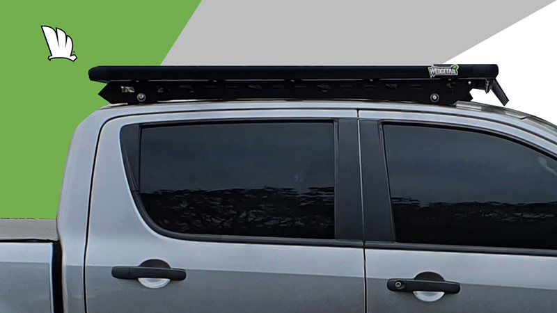 Mazda BT-50 side view of the cabin with a Wedgetail platform roof rack installed on the roof.
