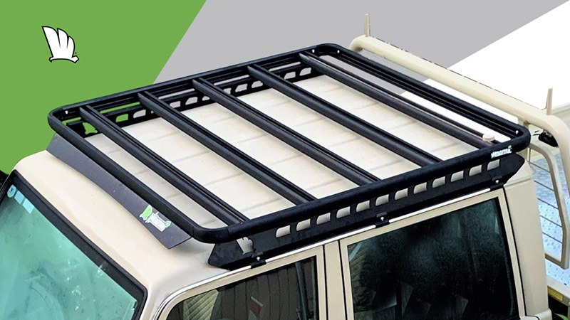 High view of the cabin of a Toyota LandCruiser 79 Series dual cab with a Wedgetail roof rack installed on the cabin showing clearly the five cross bars used to make it super strong and the one piece mounting rails supporting the roof rack platform.