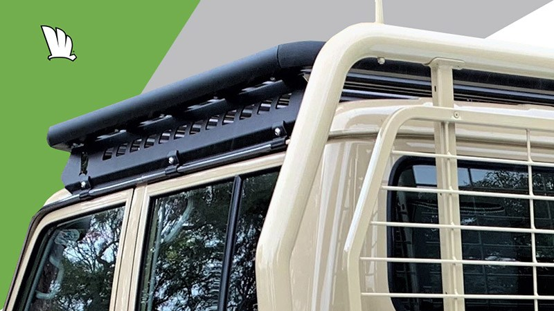 Side view of a Toyota LandCruiser 79 Series dual cab with a Wedgetail roof rack installed over the cabin roof using our one piece mounting rails.