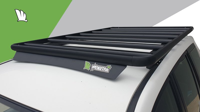 High front view of the Wedgetail rack on the Prado 120 Series showing the wind deflector, the mounting points for the one piece mounting rails and the platform on top with seven cross bars to give superior strength.