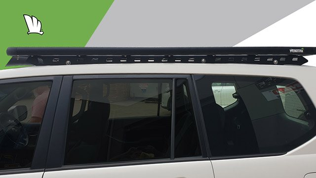Side view of the Wedgetail rack on the Prado 120 Series showing the one piece mounting rails with three connection points and the platform roof rack attached to the mounting rails.