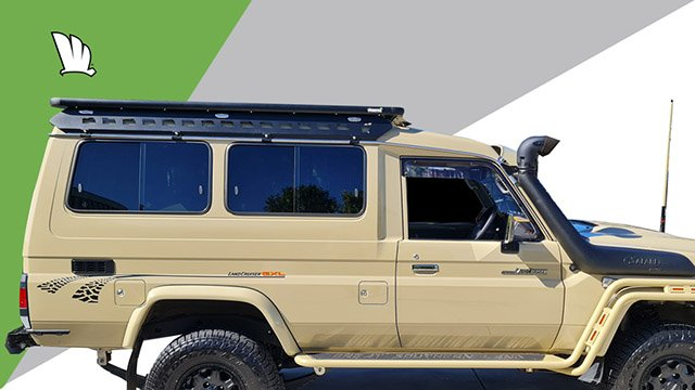 Side view of the Wedgetail rack on the 70 Series Troop Carrier showing the one piece mounting rails and the roof rack platform fixed to the top of the rails.