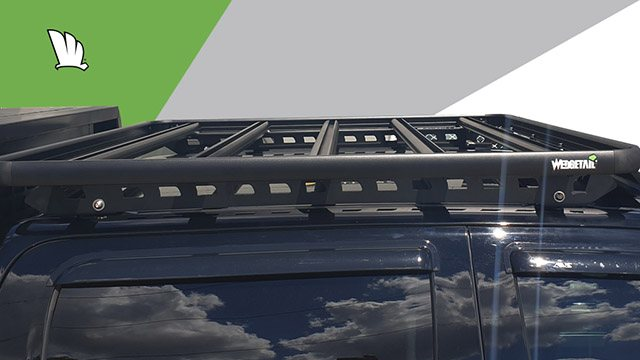 Side view of Chevrolet Silverado 1500 with a Wedgetail roof rack installed on the cabin roof showing the mounting rails and the strong cross bars and frame of the roof rack platform.