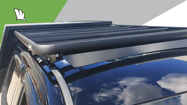 Front close up view of Chevrolet Silverado 1500 with a Wedgetail roof rack installed on the cabin roof showing a roof mounting point, the mounting rails and the wind deflector.