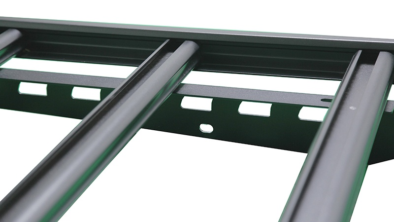 The crossbars are bolted to the frame rails at each end.