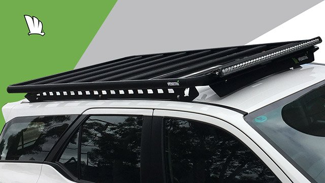 Front view of the Wedgetail rack on the Fortuner showing the owner installed light bar and our standard wind deflector, the mounting points for the one piece mounting rails and the platform on top with seven cross bars to give superior strength.