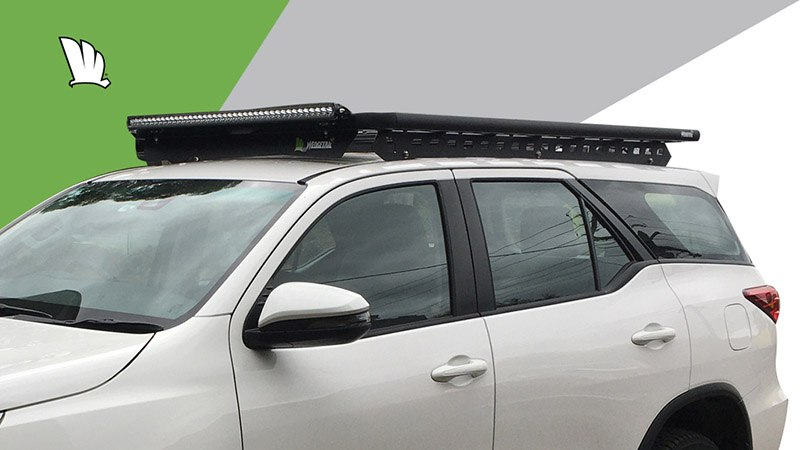 Front view of the Wedgetail rack on the Fortuner showing the owner installed light bar, our standard wind deflector and the one piece mounting rails with the platform fixed on top.