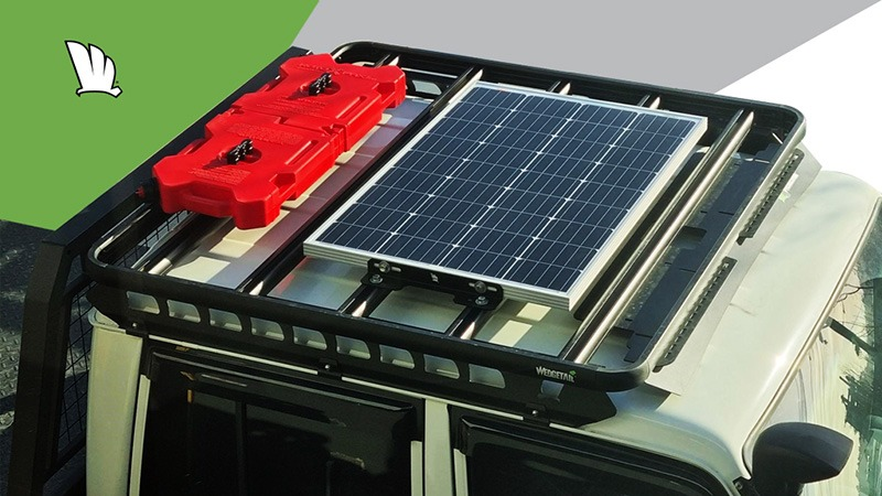Photo from above a Wedgetail rack showing a solar panel mounted on the rack using the solar panel mount kit.